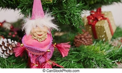 Decoration of Christmas tree witch doll toy. Pan