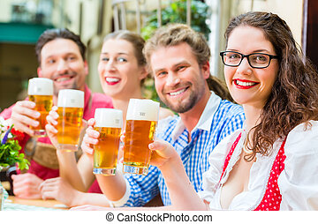 people drinking beer in Bavarian restaurant or pub