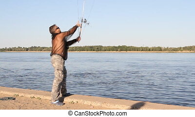 man fishing on a river - man fishing on a river at sunny day...