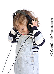 beauty a little girl listening music on white background