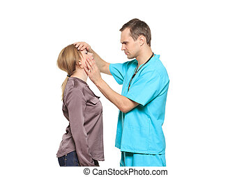 male doctor examines a female patient isolated on white...