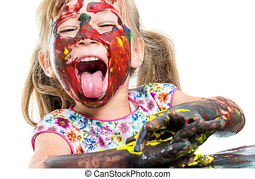 Painted girl pulling out tongue. - Close up portrait of...