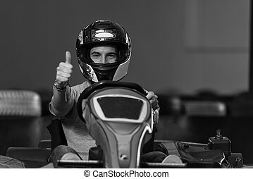 Man Showing Thumbs Up For Karting Race - Young Man Is...