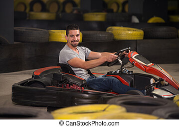 Young Man Driving Go-Kart Karting Race - Young Man Is...