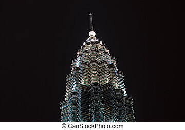Single Illuminated Petronas Tower Against Dark Sky Kuala...
