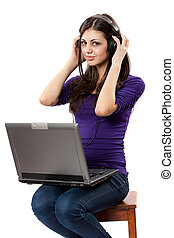 Brunette listening music from laptop