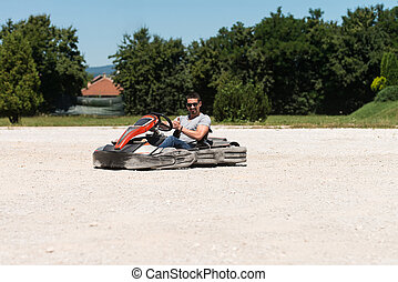 Young Man Karting Racer - Young Man Is Driving Go-Kart Car...