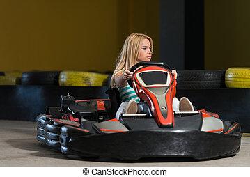 Young Woman Driving Go-Kart Karting Race - Young Woman Is...