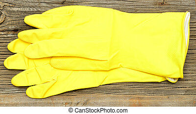 yellow latex gloves palms - A pair of yellow latex gloves...