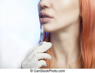 Woman Geting an Injection in her Lips in Beauty Salon -...