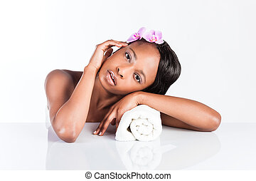 Beautiful African woman in Studio with towel