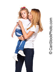 young mother and her little daughter isolated on white -...