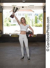 Woman Is Holding Cup Speed Karting Race - Young Woman Is...
