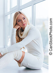 Feeling sad and lonely. Thoughtful young woman in white...