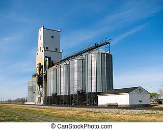 Grain Elevator with Blue Sky - Grain Elevator and Bins with...