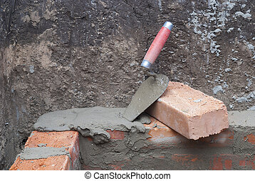 bricklaying - against the background of the brickwork is...