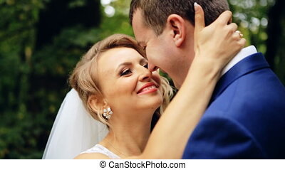 Loving caucasian couple looking into each others  wedding shot in slow motion  close up