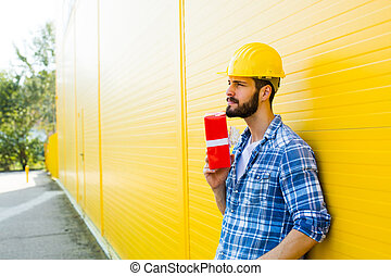 worker with a gift in hands - adult worker with yellow...