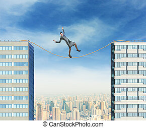 Businesswoman on the rope - Businesswoman balancing on the...