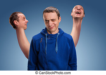 Man with three heads - Concept of split personality, a man...