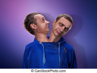 Man with two heads - Concept of split personality, a man...