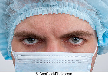 Surgeon in surgical mask - Portrait of serious surgeon in...