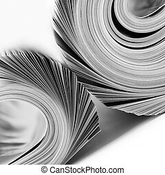 Rolled up magazines. B/W