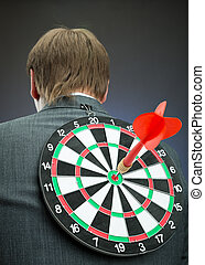 Businessman with darts board on his back - Businessman with...