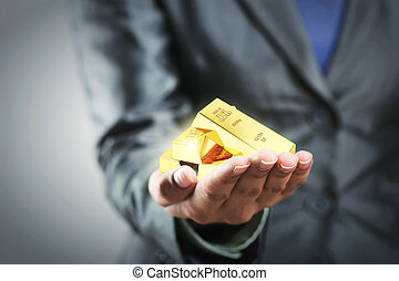 Golden bars on the woman's hand - Four golden bars on the...