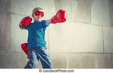 Battle - Little boy with boxing gloves