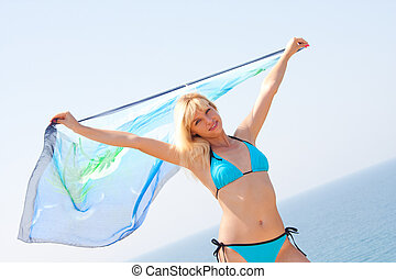 Woman with sarong - Beautiful woman with sarong in the wind