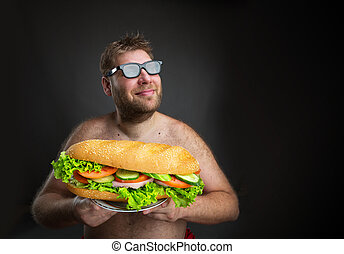 Man with sandwich - Fat happy man in glasses with sandwich...