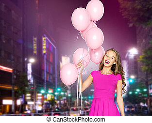 happy young woman with balloons over night city - people,...