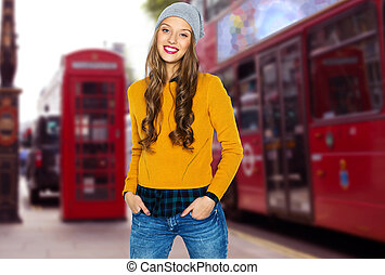 happy young woman or teen over london city street - people,...