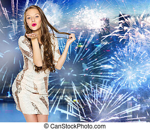 happy young woman or teen over firework at city - people,...