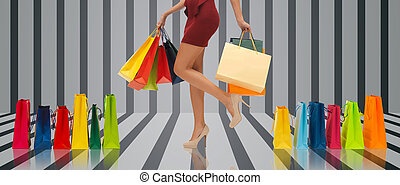 close up of woman on high heels with shopping bags - people,...