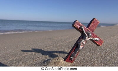 ocean beach and old crucifix - empty ocean beach with old...