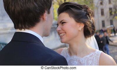 Young beautiful couple laughing bride and groom in the city shot in slow motion  close up