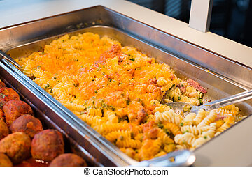 close up of pasta and meatballs on catering tray - food,...