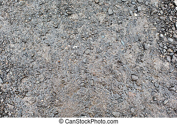 close up of wet gray gravel road or ground - background and...
