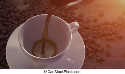 Pouring coffee surrounded by coffee beans