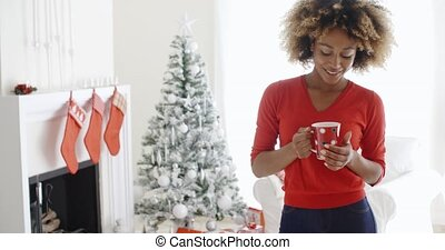Friendly smiling young woman celebrating Christmas -...