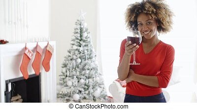 Young woman offering a Christmas toast - Attractive young...