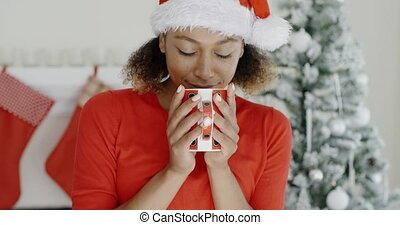 Young woman enjoying hot coffee at Christmas - Young woman...