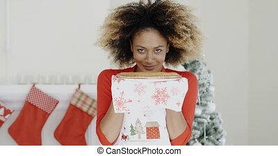 Happy young woman holding a Christmas pastry - Happy young...