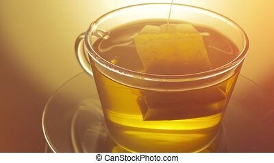 Glass cup of tea with teabag close up - Fresh glass cup of...