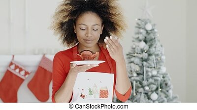 Young cook with a freshly baked Xmas cake - Young African...