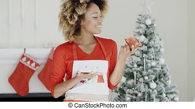 Pretty young woman with a Christmas cake - Pretty young...