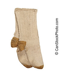 Old ragged woolen socks isolated on a white background...