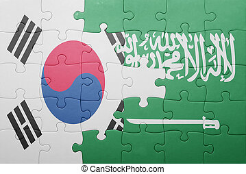puzzle with the national flag of saudi arabia and south...